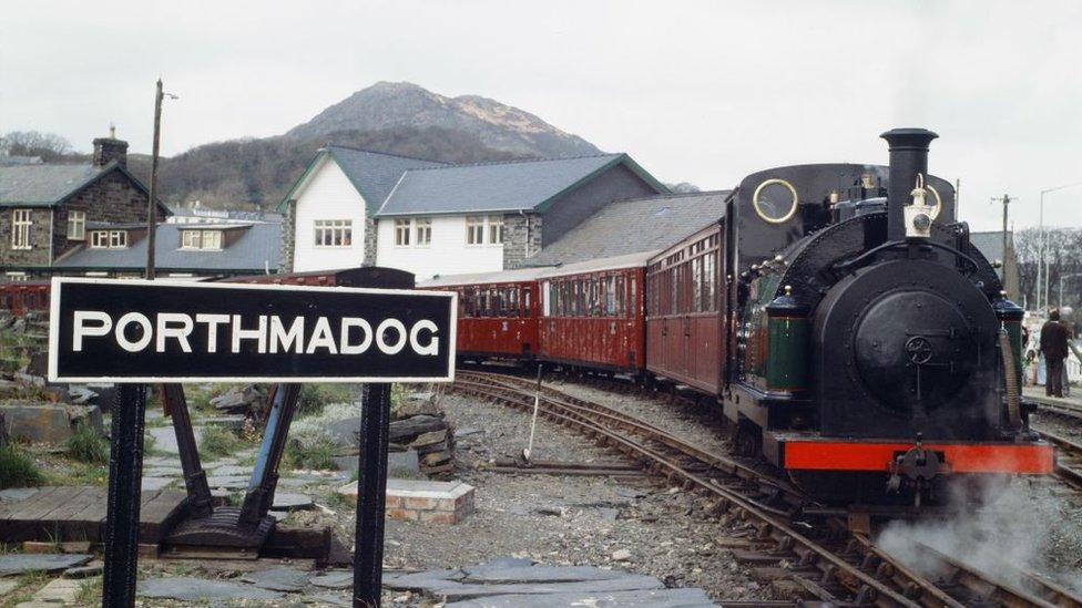 A train leaves Porthmadog