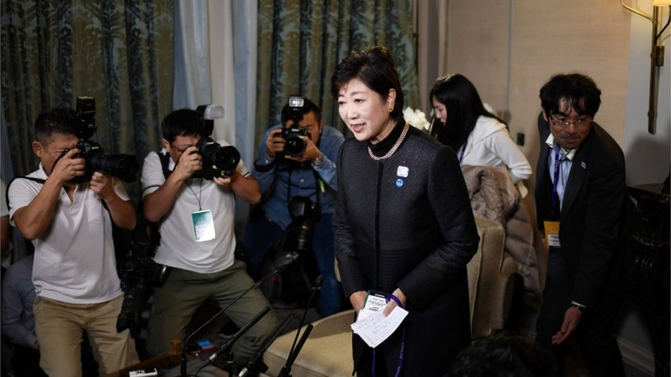 Yuriko Koike, governor of Tokyo, photographed submitting her vote on October 22 2017