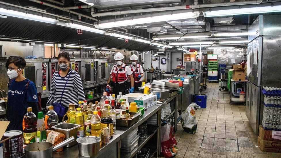 A team walk though a canteen kitchen at PolyU