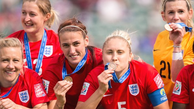 England collect their bronze medals