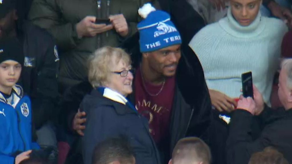 'This is why we love football' - Steve Mounie gives shirts to fans in stands