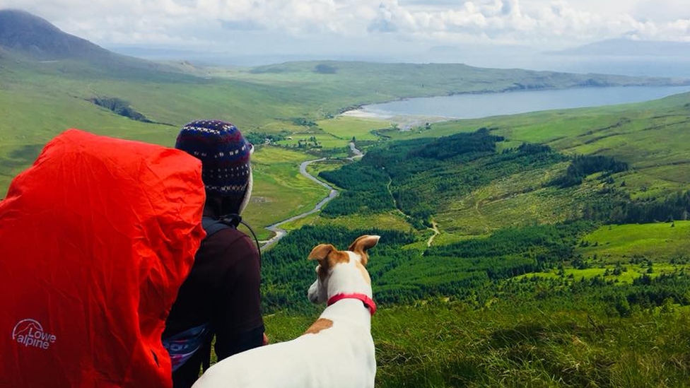 Chris Lewis and Jet overlooking the scenery in Scotland