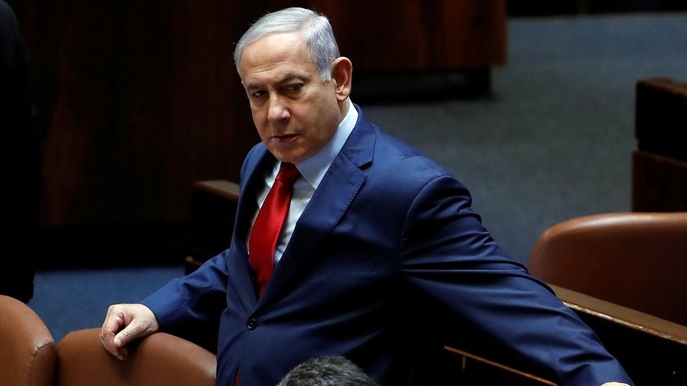 Israeli Prime Minister Benjamin Netanyahu arrives to the plenum at the Knesset