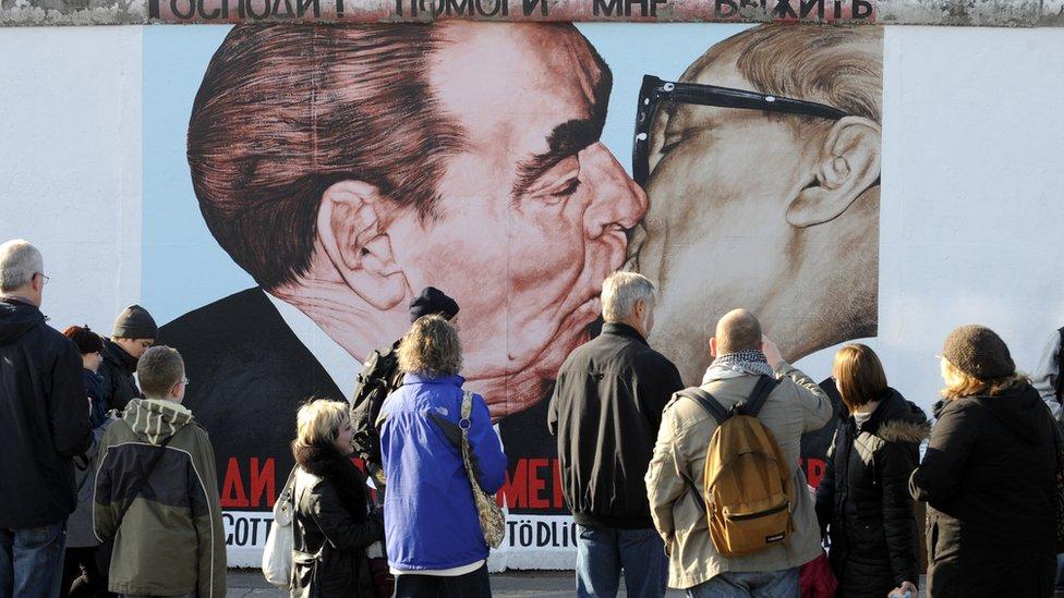 "Painting in Berlin of a ""fraternal kiss"" between former Soviet leader Leonid Brezhnev and East German leader Erich Honecker"