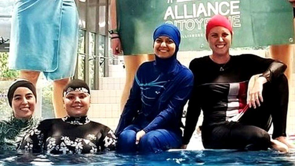 Muslim women defy ban to swim in burkinis at French pool