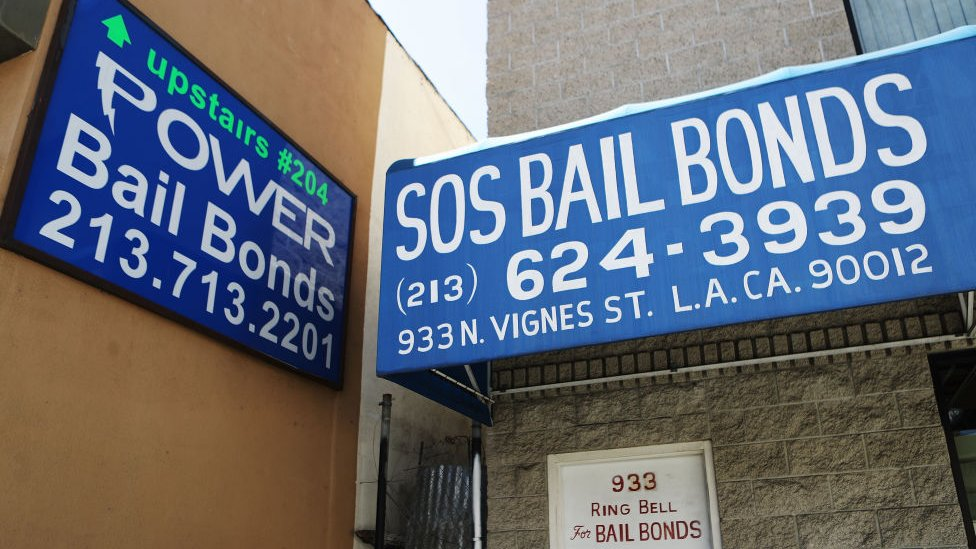 Signs advertise bail bond companies on August 29, 2018 in Los Angeles, California