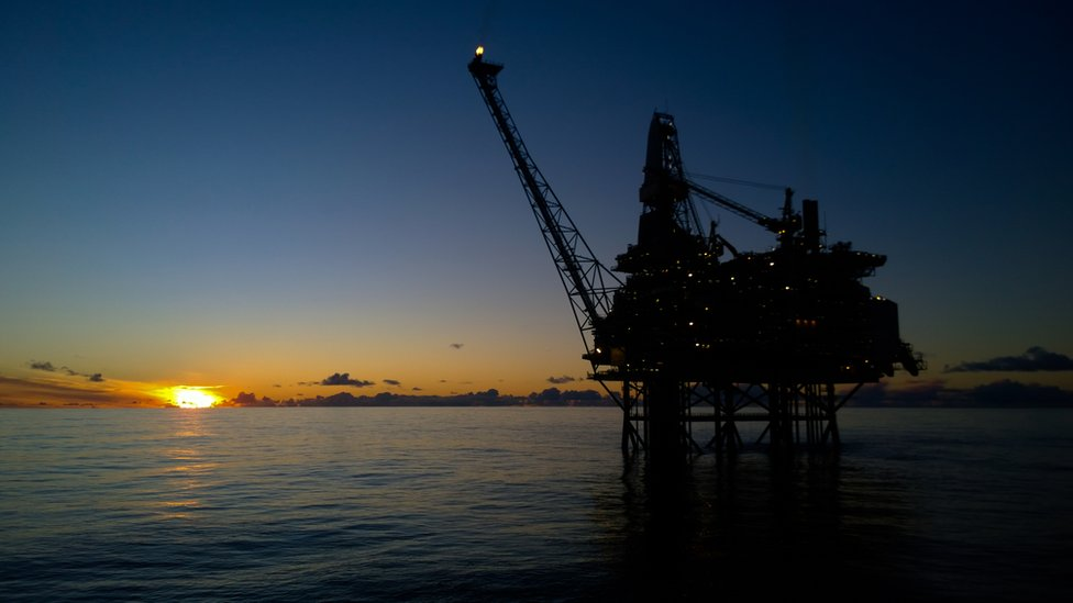 Sunset behind oil installation
