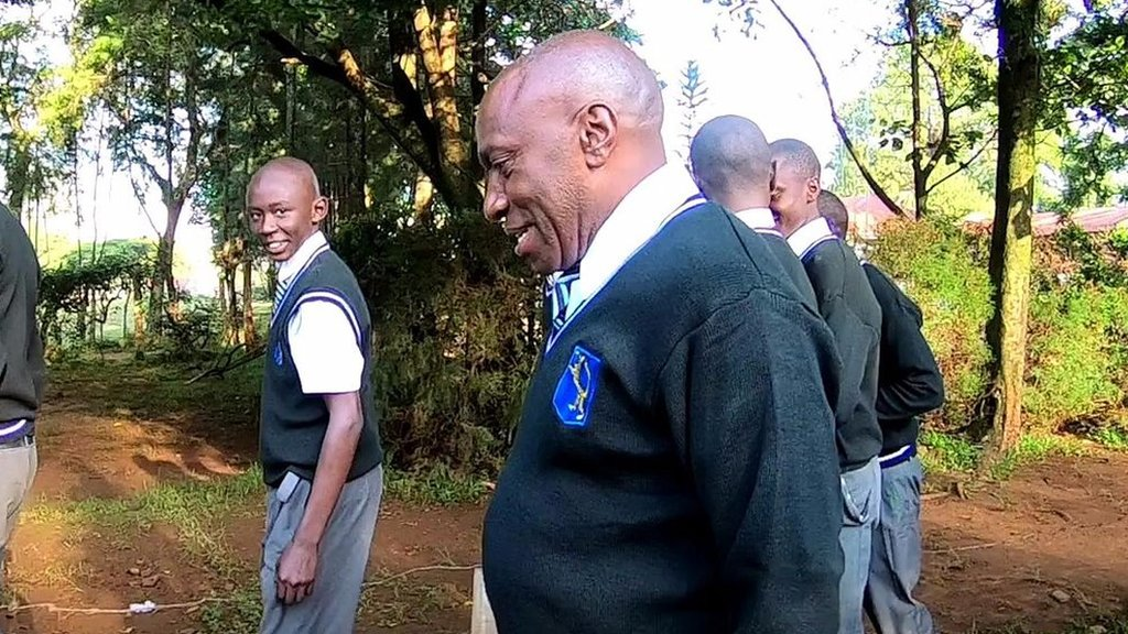 Why this Kenyan teacher wears a school uniform