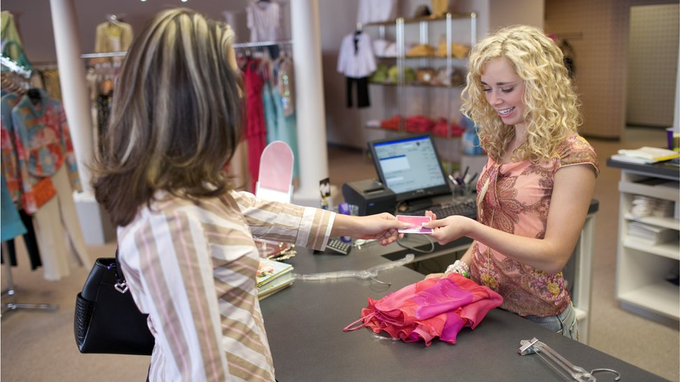 Shopper paying for goods