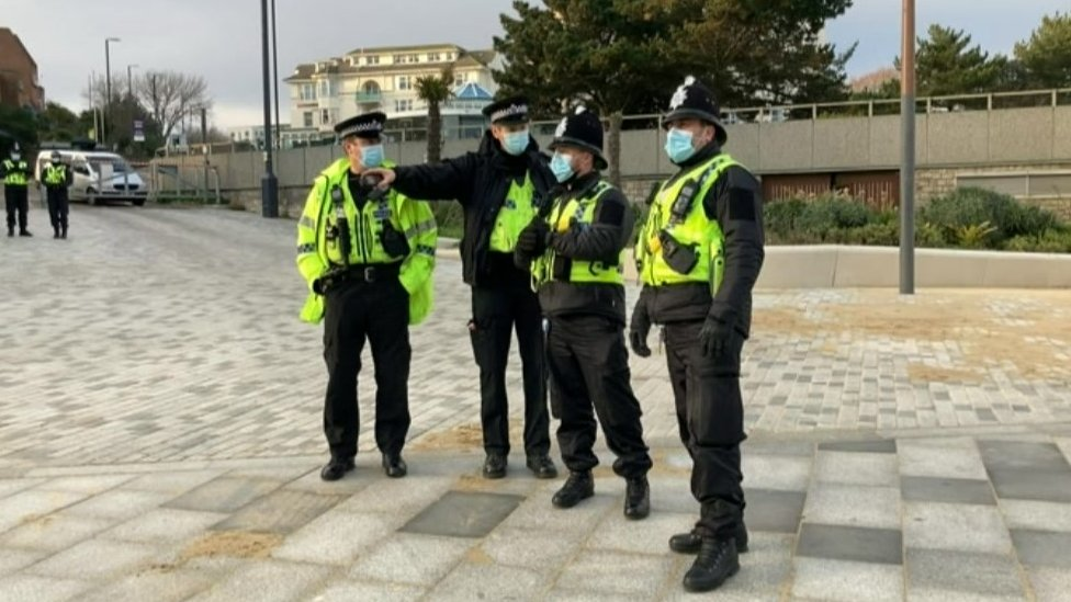Police at Bournemouth protest