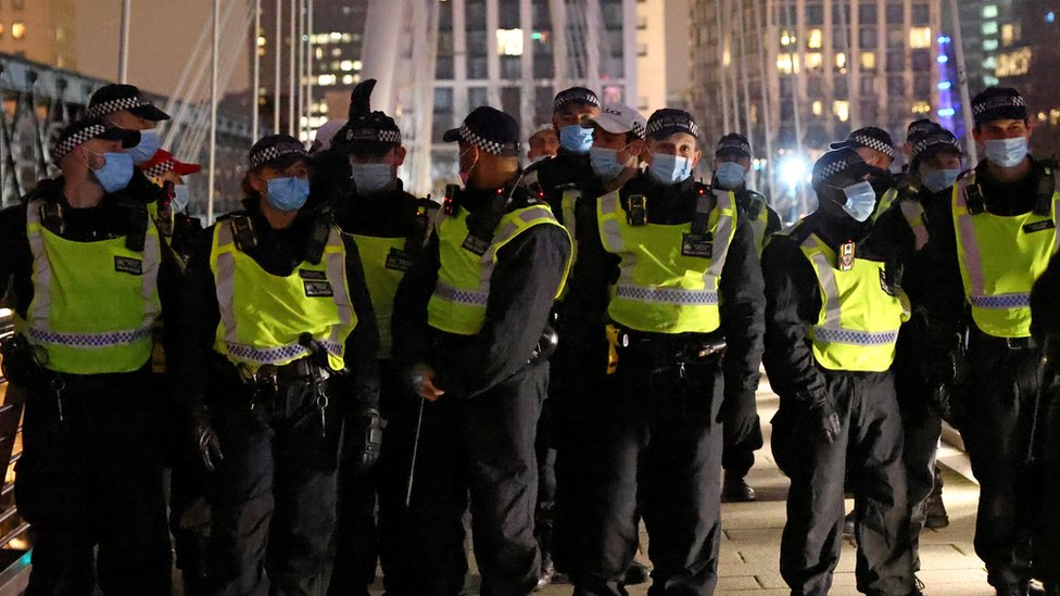 Police at an anti-lockdown protest in London on 1 January