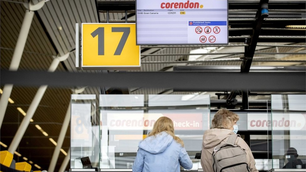 Tourists at the Schiphol Airport wait for their flight to Gran canaria, Spain, as they take part in the second Fieldlab trial holiday amid coronavirus pandemic in Schiphol, the Netherlands, 01 May 2021