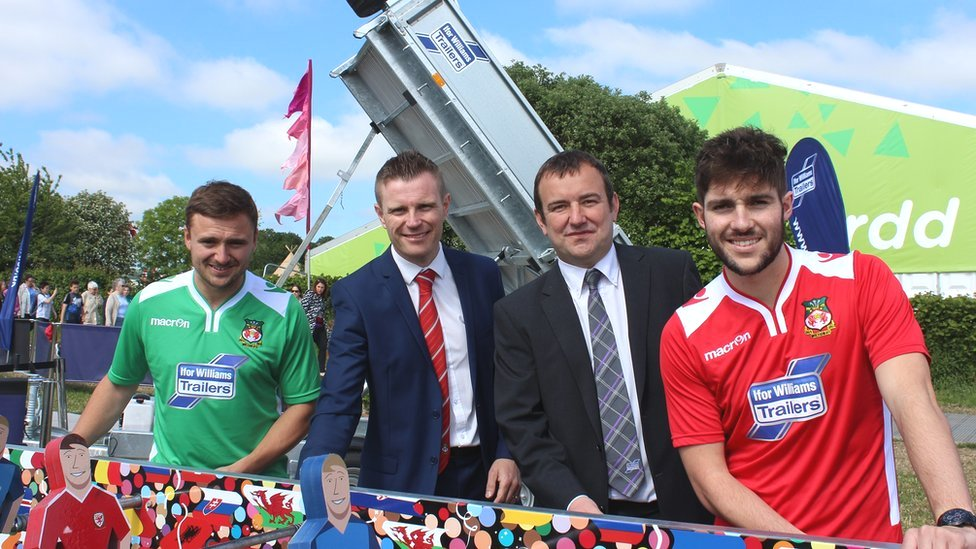 Wrexham players Paul Rutherford and Robbie Evans modelling next season's shirts.