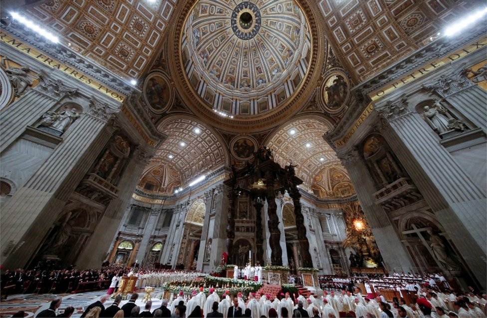 A picture of Mass on Holy Saturday highlighting the spectacular ceilings of Saint Peter's Basilica in the Vatican