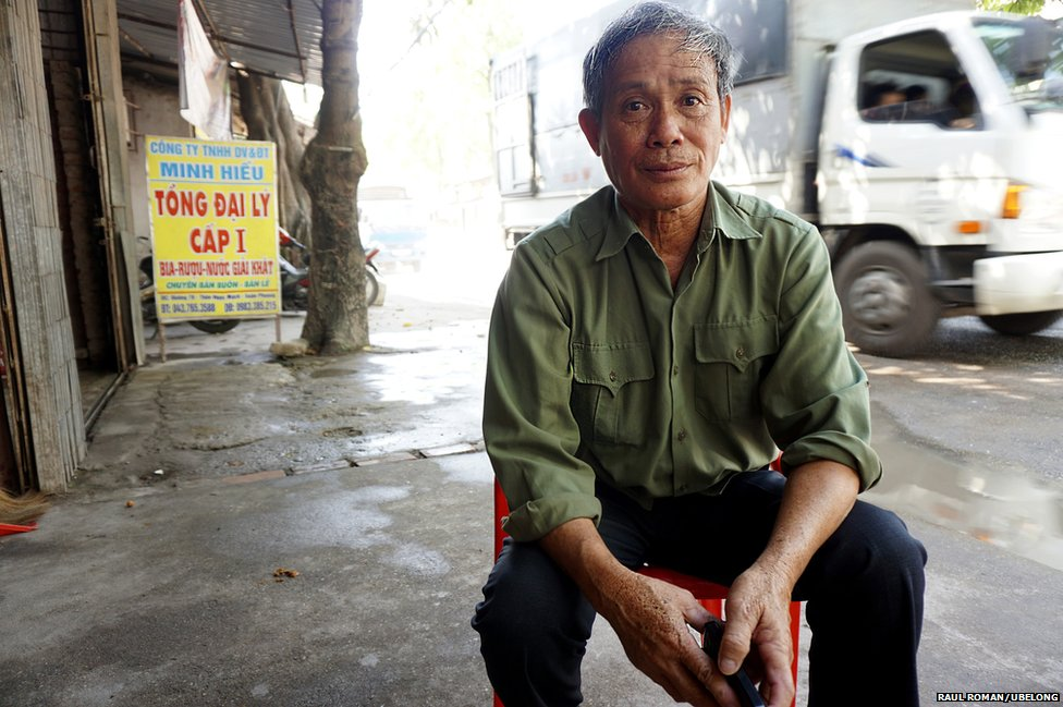 Luong Duc Pho, 62, sits on a bar stool in the outskirts of Hanoi