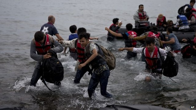 Migrants arrive on the shores of the Greek island of Lesbos after crossing the Aegean Sea from Turkey