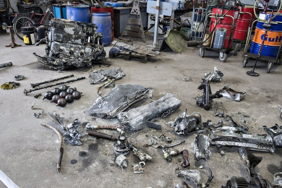 Debris from the wreck of a World War II era fighter plane that was found by Daniel Rom and Klaus Kristensen yesterday, sits in a building near Birkelse by Aabybro in Northern Jutland, Demark, 07 March 2017.