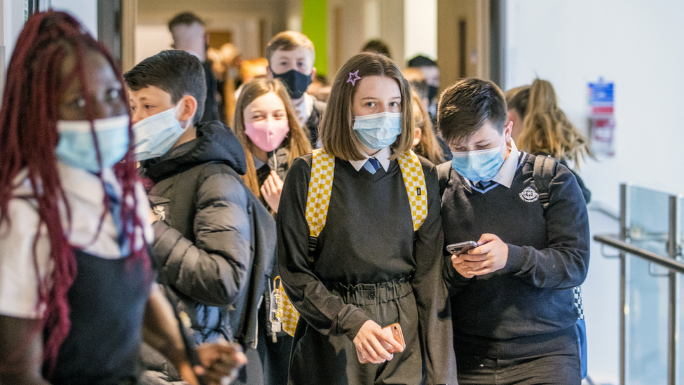 Students wearing protective face masks