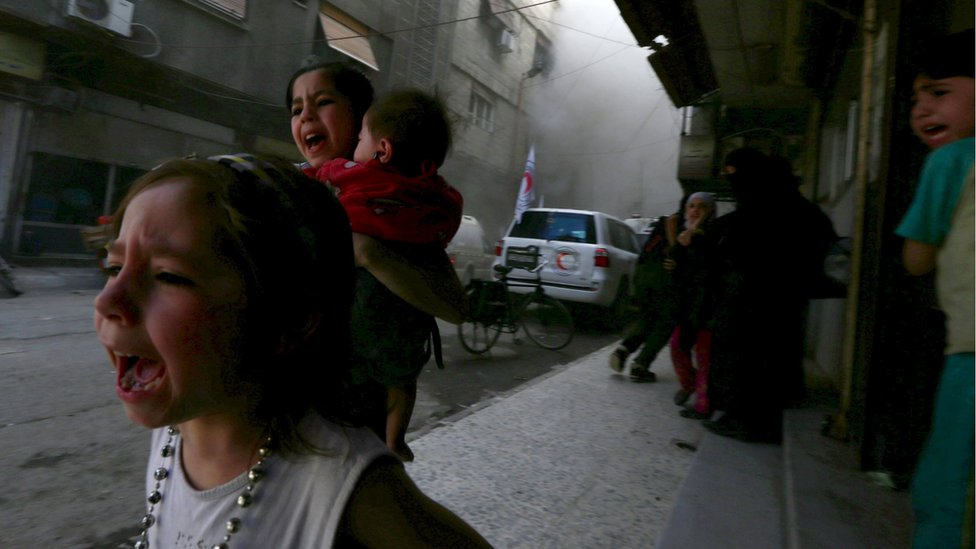 Children fleeing shelling in the Douma neighbourhood of Damascus