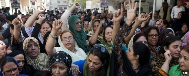 MQM supporters political party shout slogans as they gather outside the MQM headquarters following a raid by paramilitary rangers in Karachi on March 11