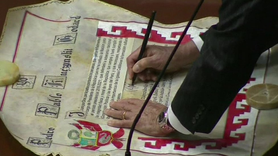 Pedro Pablo Kuczynski signs a certificate which formalised the presidency