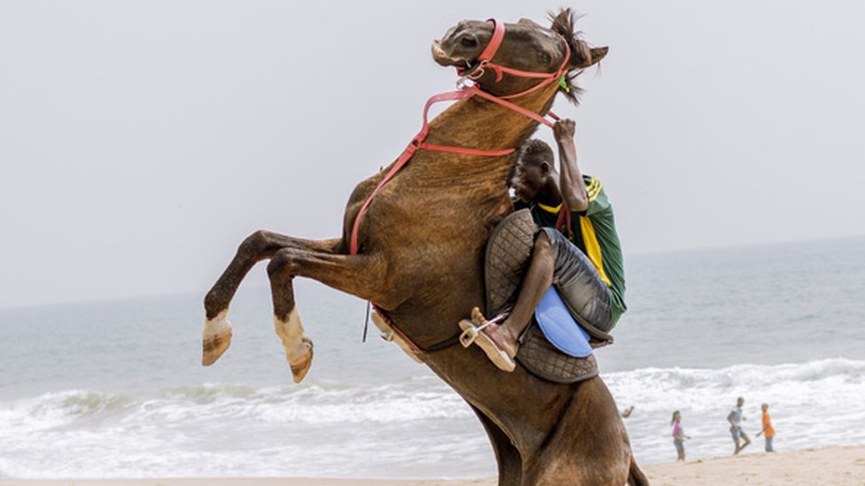 The horsemen making a living on Lagos beach Nigeria