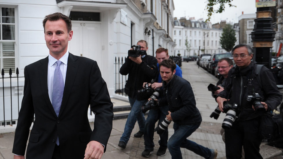 Jeremy Hunt being pursued by the press in 2012