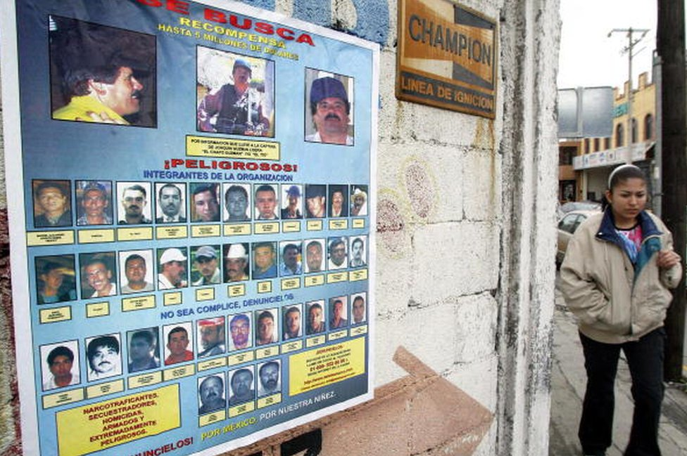 A wanted poster in Monterrey, Mexico features El Chapo at the top