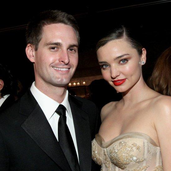Snapchat founder Evan Spiegel (L) and his wife, model Miranda Kerr