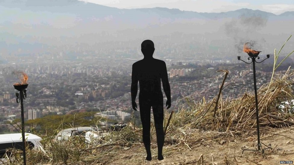 """A figure symbolizing missing people is pictured during a ceremony at """"La Escombrera"""" rubbish dump in Medellin."""