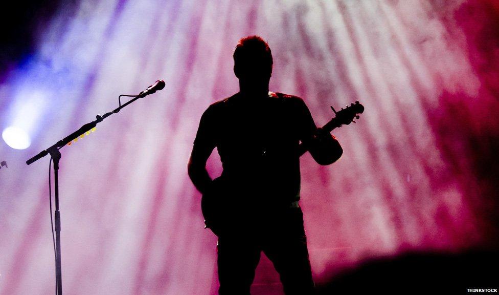 Guitarist in silhouette