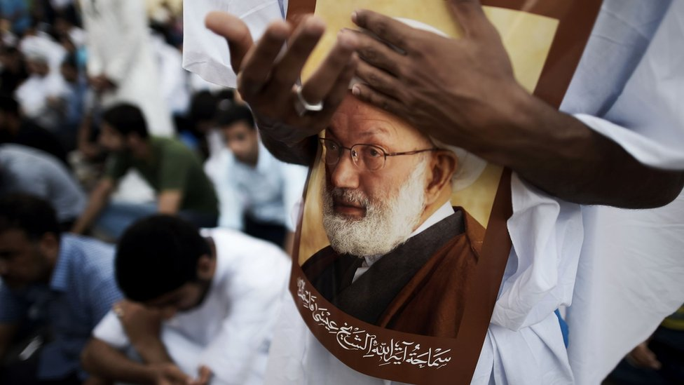 Bahrainis attend a protest against the revocation of the citizenship of Shia cleric Sheikh Isa Qassim on 20 June 2016, near his house in the village of Diraz