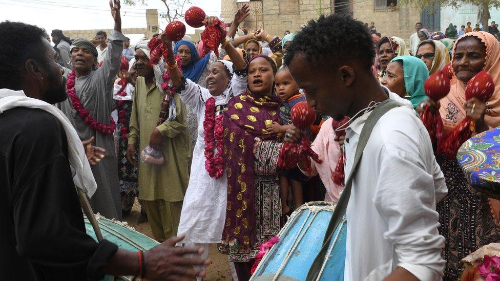 Pakistani devotees of the Sidi ethnic group play traditional music at the shrine of Sufi Hasan-al-Maroof Sultan Manghopir