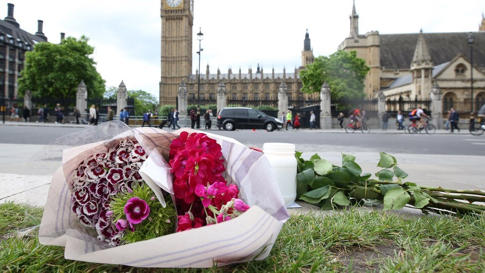 Flowers left at Parliament Square opposite the Palace of Westminster