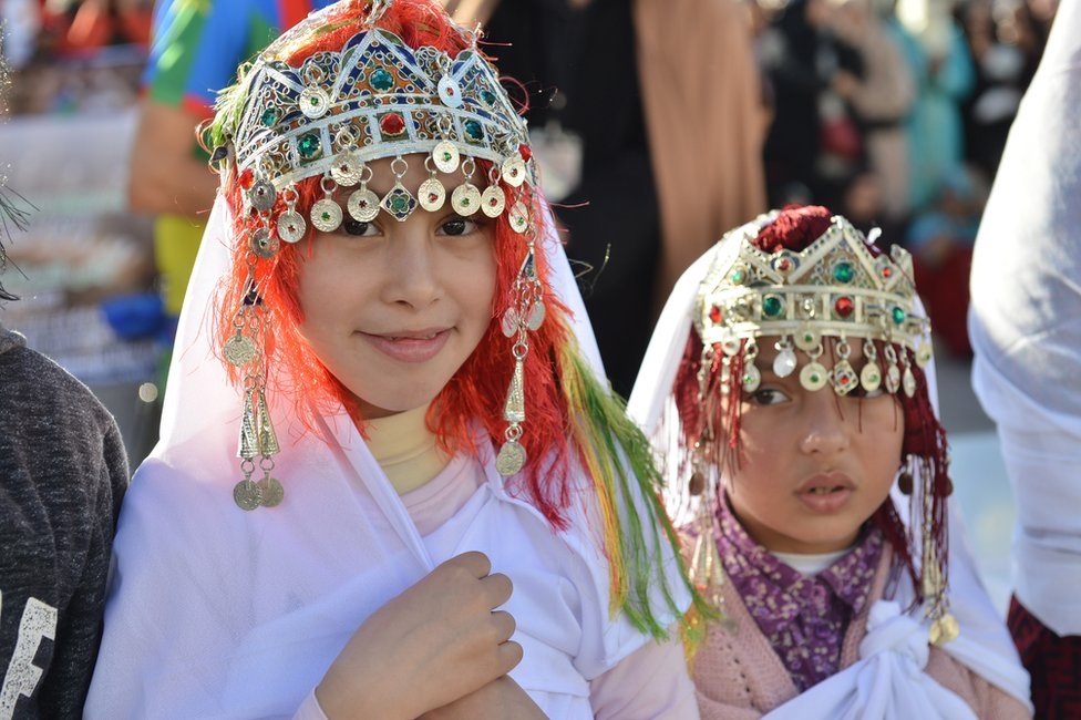 Amazigh girls wear traditional clothes on the eve of the 2970th Amazigh New Year near the parliament in the capital of Rabat, Morocco, 12 January 2019