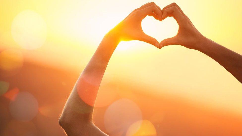 hands make the shape of a heart