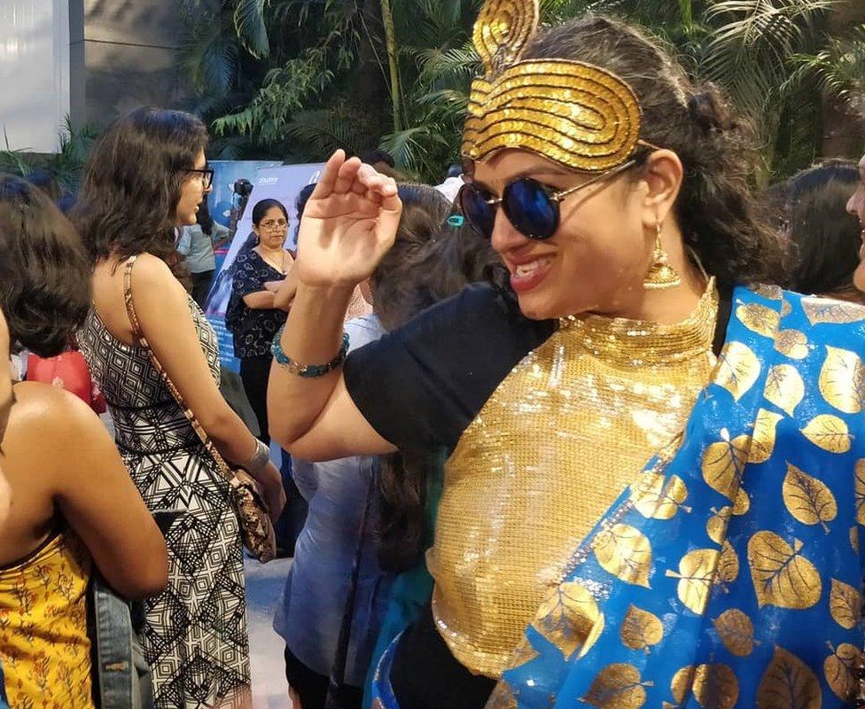 Nimi Ravindran of Sandbox Collective striking a pose as Nagina
