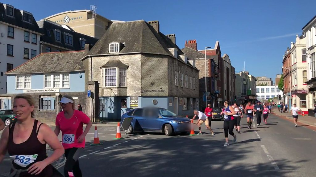 Woman drives car through half marathon in Plymouth