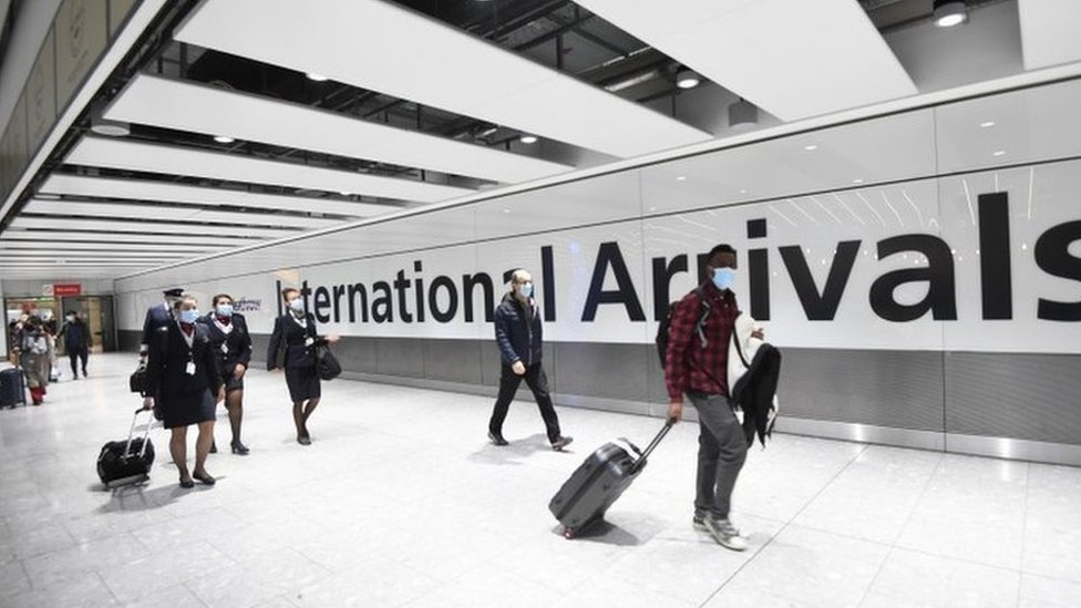 Travellers arrive at London's Heathrow Airport