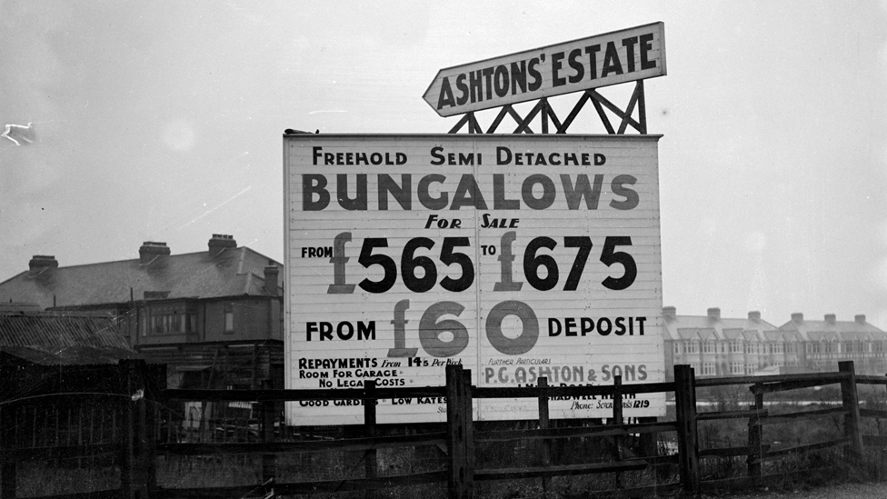1937: A sign advertising freehold semi-detached bungalows for sale in Chadwell Heath, Essex