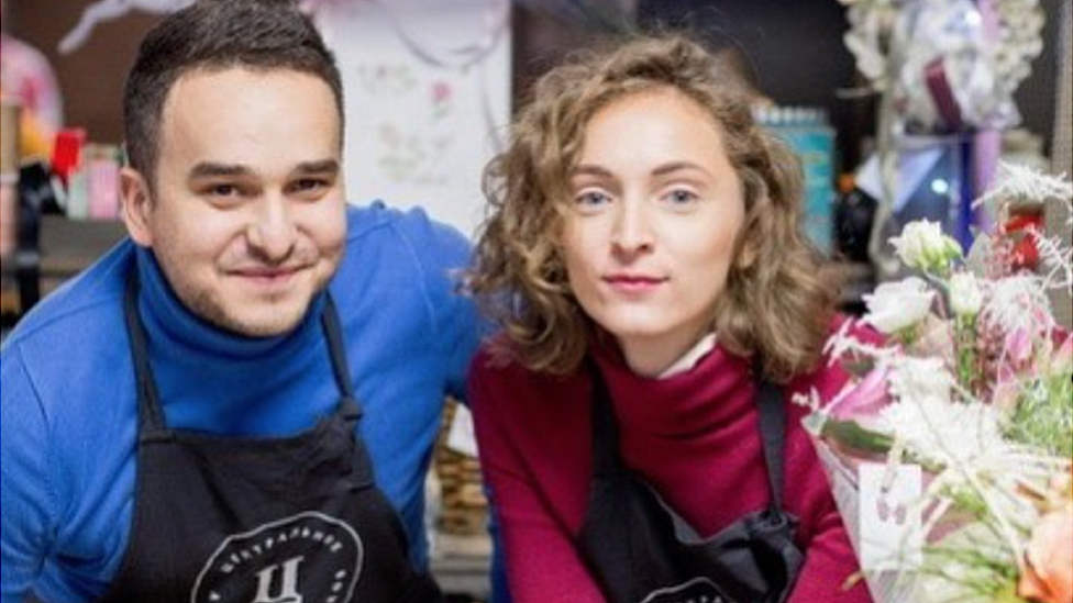 Maksim Khoroshyn and his wife posing in their flower shop