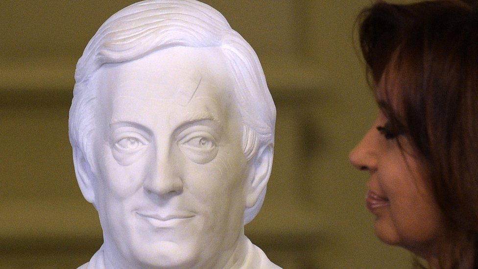 Argentine President Cristina Fernandez de Kirchner looks at a bust of late Argentine Presidnet (2002-2007) Nestor Kirchner after unveiling it during a farewell rally on her last day in power at Government Palace in Buenos Aires on December 9, 2015.