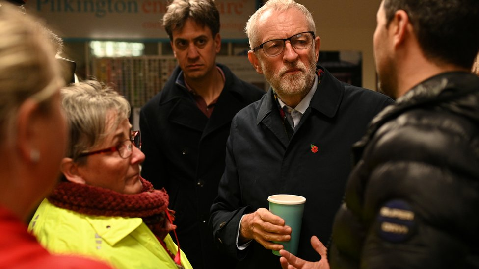 Jeremy Corbyn and Ed Miliband talks to flood-affected residents
