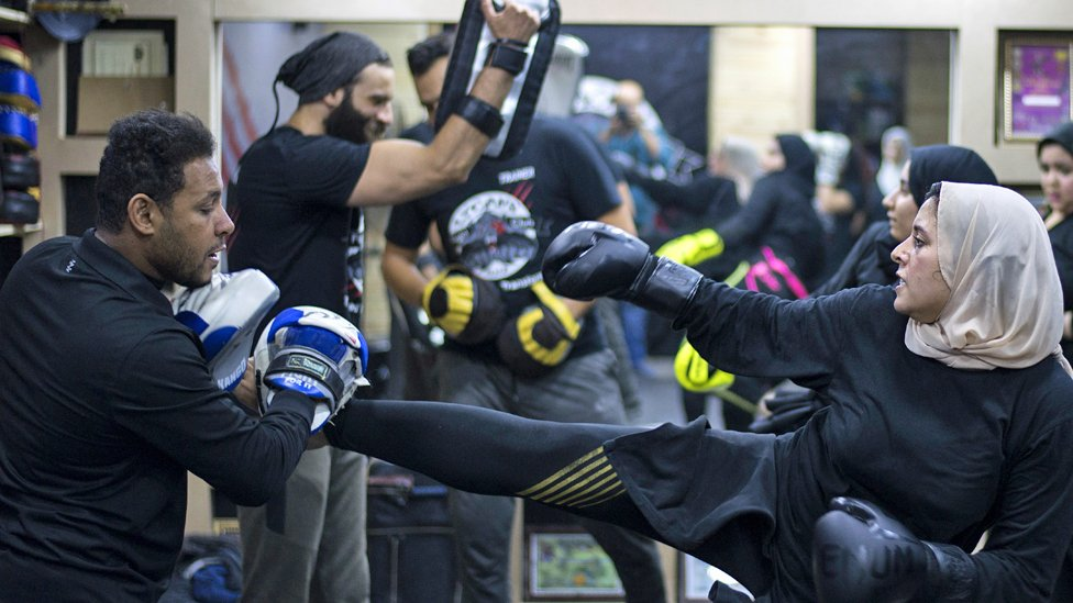 A woman kick-boxing during a mixed martial arts class in Giza, Egypt - Sunday 24 November 2019