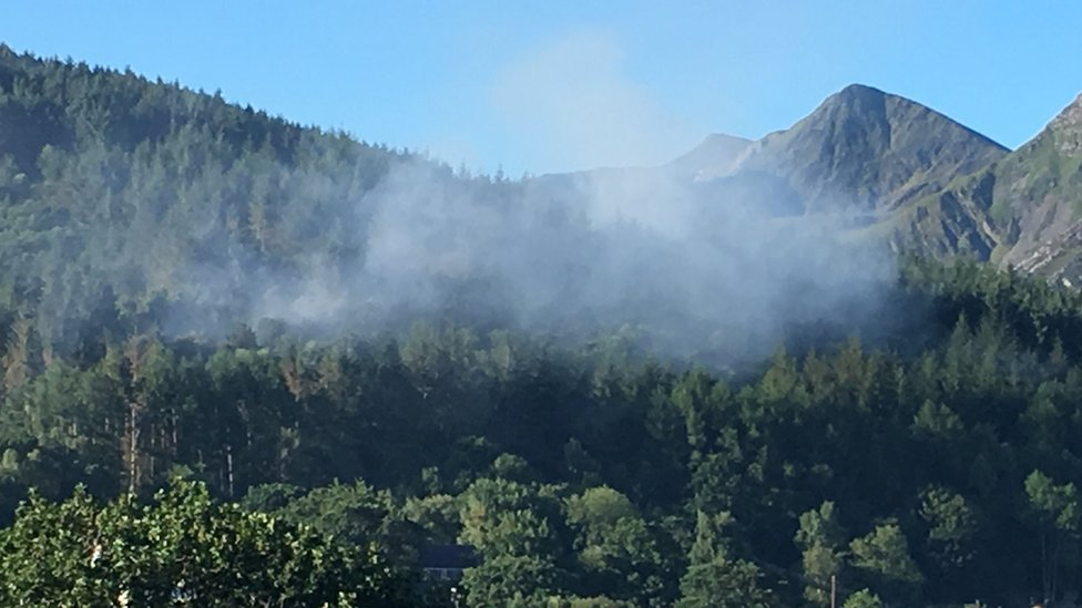 Smoke billows from the forest in Braichmelyn