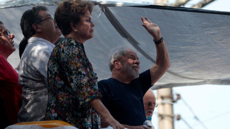 Former Brazilian President Luiz Inacio Lula da Silva waves as he attends a mass for his late wife in Sao Bernardo do Campo, Brazil, 7 April
