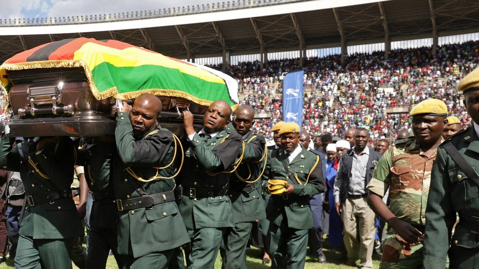 Pallbearers carry the coffin of the late Zimbabwean jazz and afro pop musician Oliver Mtukudzi as it departs at the National Sports Stadium in Harare,
