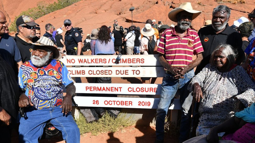 Aboriginal elders gather for a ceremony ahead of a permanent ban on climbing Uluru that comes into place on October 26, at Uluru,