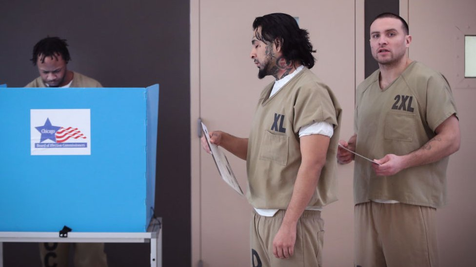 Men cast their ballots at Cook County Jail during the Illinois primary election