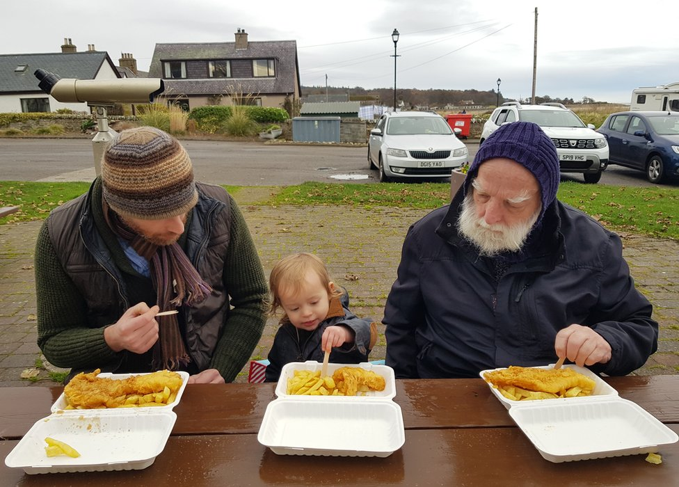 People eating chips